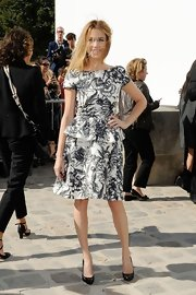 Marie-Josee was right on trend in this print boatneck peplum dress ta the Dior show.