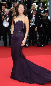 Gong Li donned a strapless eggplant evening gown with a long strain and sparkling structured bodice for the 'Midnight in Paris' premiere at Cannes.
