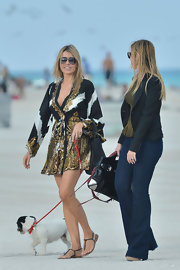 Rita Rusic was snapped strolling around Miami in an eye-catching sequined print dress.