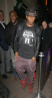 Oritse Williams added a pop of color to his outfit with a pair of red lace-up boots.