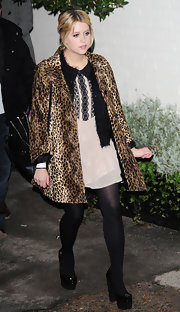 "Peaches Geldof opted for a fashion forward look in the architectural Office ""Late Nights"" platforms. She wore the black patent pumps with opaque tights and a darling mini dress."