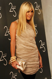 Actress Tinsley Mortimer paired her one-shoulder dress with three matching bangle bracelets.