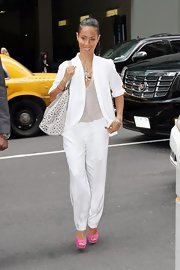 Jada Pinkett Smith looked super cool in this white pant suit and glittering blouse out in NYC.