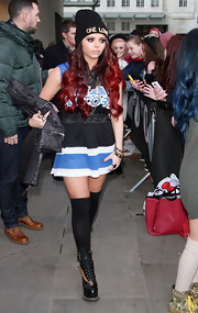 Jesy Nelson opted for a stylish mini-dress with stripes for her punk-inspired look at the BBC Radio Studios.
