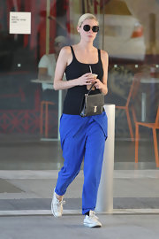 Jaime King stepped out in a pair of electric blue harem pants.