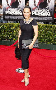Tia Carrere paired her curve hugging black dress with an over-sized metallic clutch. In this case it looked a bit over baring.