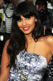 Jameela wore her eye-grazing bangs straight and shiny whilst leaving the rest of her hair in relaxed natural waves.