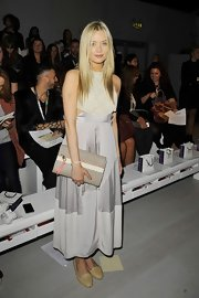 Laura Whitmore added a bit of edginess to her airy look with a pair of studded nude flats during London Fashion Week.