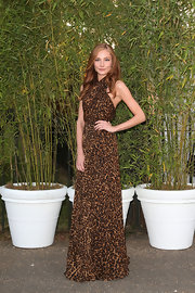 Clara Paget chose a long leopard-print frock for her sexy look at the Serpentine Gallery Summer Party in London.