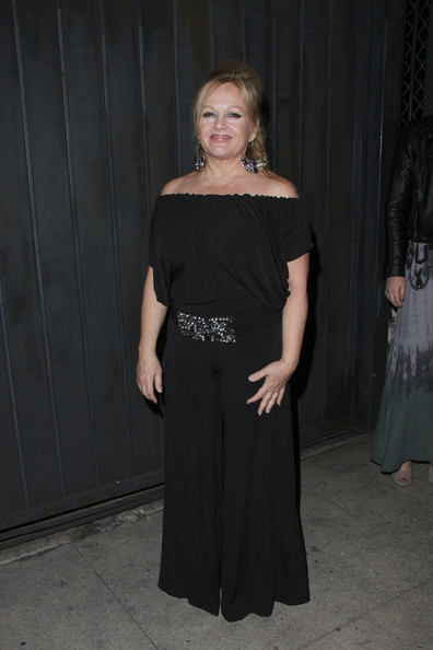Charlene goes for a 70's look in an off the shoulder jumpsuit.