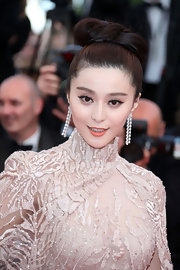 Fan Bingbing arrived at the 'Rust and Bone' premiere at the Cannes Film Festival wearing her long locks in s sleek loose bun.