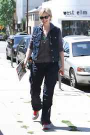 Jane Lynch kept her daytime look cool and casual with this denim vest paired over a hoodie.