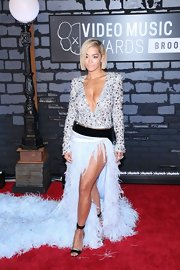 Rita was all about the drama at the VMAs, as she showed when she wore this powder blue gown that featured a jeweled plunging neck and a long feathered train.