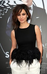 Berenice had some fun at the Paris photocall in this black feathered bodice.