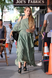 Jemima stayed true to her hippie chic reputation when she wore this olive green glowing maxi.