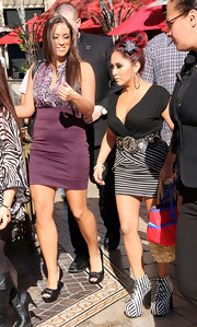 Snooki topped off her daring style with black and white striped platform lace-up ankle boots.