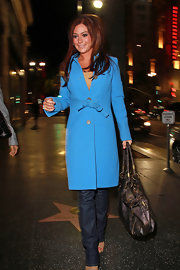 Jenni wears a bright blue long wool coat while out in Hollywood. This color really pops with her red locks.