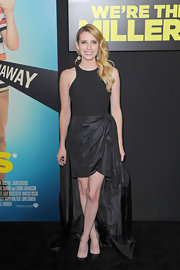 Emma Roberts stunned in a draped black dress at the premiere of 'We're the Millers.'