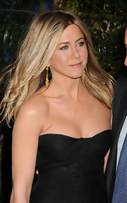 Actress Jennifer Aniston highlighted her strapless Dolce and Gabbana dress with 19th Century gold pendant earrings.