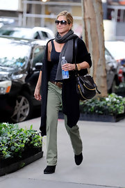 While out and about town, Jen opted for green cargo pants paired with black leather lace-up booties.