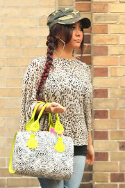 Snooki wore a leopard print blouse with her eclectic ensemble while out and about with JWoww.