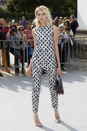 Elena wasn't afraid of the matching game when she sported these white and black patterned pants and top.