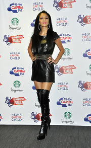 Nicole Scherzinger opted for an edgy look at the Summer Ball in black leather over-the-knee platform boots.