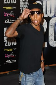 Pharrell showed off his arm tattoo while hitting the World Music Awards.