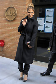 Jennifer Lopez bundled up in this classic wool coat with a tie belt while out in NYC.