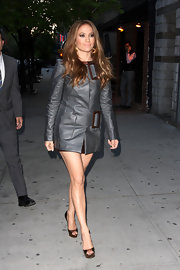 JLo showed off her stellar gams while  making her way to the David Letterman studios. The metallic leather buckle coat was fancy enough to be a dress.