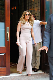 Jennifer Lopez has a serious addiction to jumpsuits. Check out this sleek nude number!