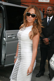 'American Idol' judge Jennifer Lopez was spotted leaving Claridge's Hotel wearing oval Pop Drop earrings. The perfect accent to her bandage dress.