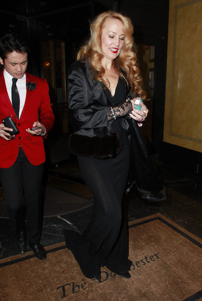 Jerry Hall is seen leaving the Make A Wish foundation carrying a fur covered evening bag. Very old school glamour.