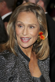 Lauren Hutton let a little peep of color peek out from her tresses to add a touch of fun to this polished look.