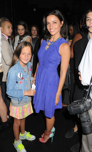 Shoshanna Lonstein was a lovely mix of colors in her pastel-hued sandals and bright blue dress.