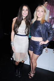 Chloe Bridges was edgy-chic at the Charlotte Ronson fashion show in a white mesh-panel dress and black knee-high boots.