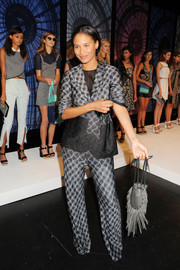 Joy Bryant chose a patterned gray pantsuit for the Charlotte Ronson fashion show.