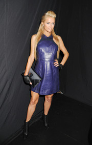 Paris Hilton finished off her fierce ensemble with a pair of stylish black ankle boots.