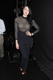 Kate Nash showed her sultrier side in a tight-fitting black jumpsuit with a sheer-illusion bodice during the Charlotte Ronson fashion show.
