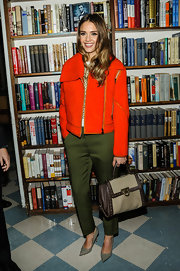 Jessica Alba sported a feminine version of the classic motorcycle jacket when she wore this orange number.