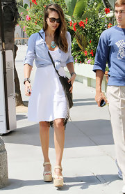Jessica Alba looked easy breezy in this white day dress under a knotted chambray shirt.