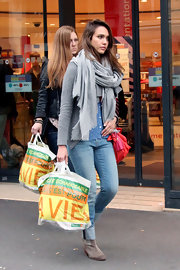 Jessica Alba wore this thick gray scarf with her casual ensemble while out shopping during Paris Fashion Week.