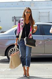 Jessica Alba made even a basic black tee and jeans dress with a pink abstract-print blazer.