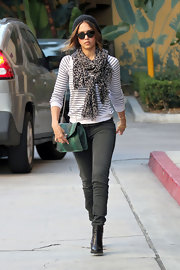 Jessica Alba showed off her style prowess in a cool and casual ensemble. She accessorized the look with a printed scarf and black leather ankle boots.