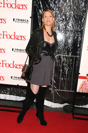 Teri goes all out with this leather look. She dons a draped leather jacket with suede boots and a leather clad mini dress.