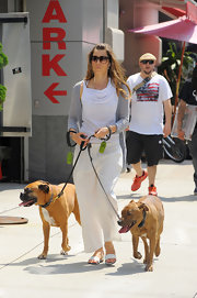 Jessica Biel stepped out in a summery cream-colored pair of wide leg pants to walk her two dogs.