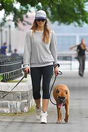 Jessica Biel played the casual card when she wore a light gray sweatshirt with a pair of workout leggings.