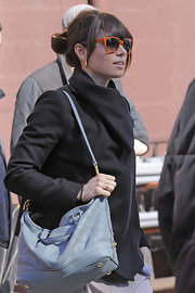 Jessica Biel add trendy pastels to her street style with a baby blue monogrammed purse.