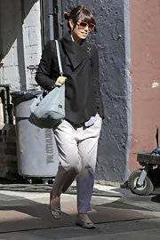 Jessica Biel finished off her relaxed look with drop-waist pants and a cozy wrap coat.
