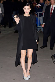 To match her dark romantic vibe, Rooney Mara teamed her A-line shift with an architectural black coat.